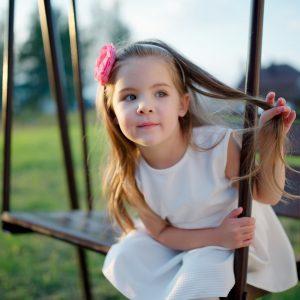 happy girl on the swings