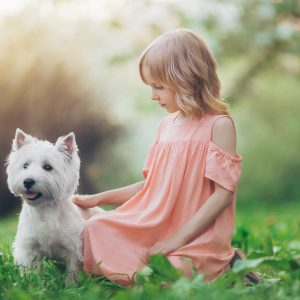 Little girl with a dog outdoors